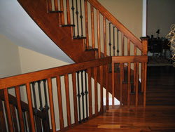 curved maple railings stained to match a tigerwood hardwood